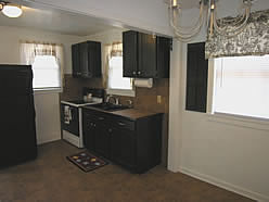 All new kitchen with refrigerator and smoth top stove